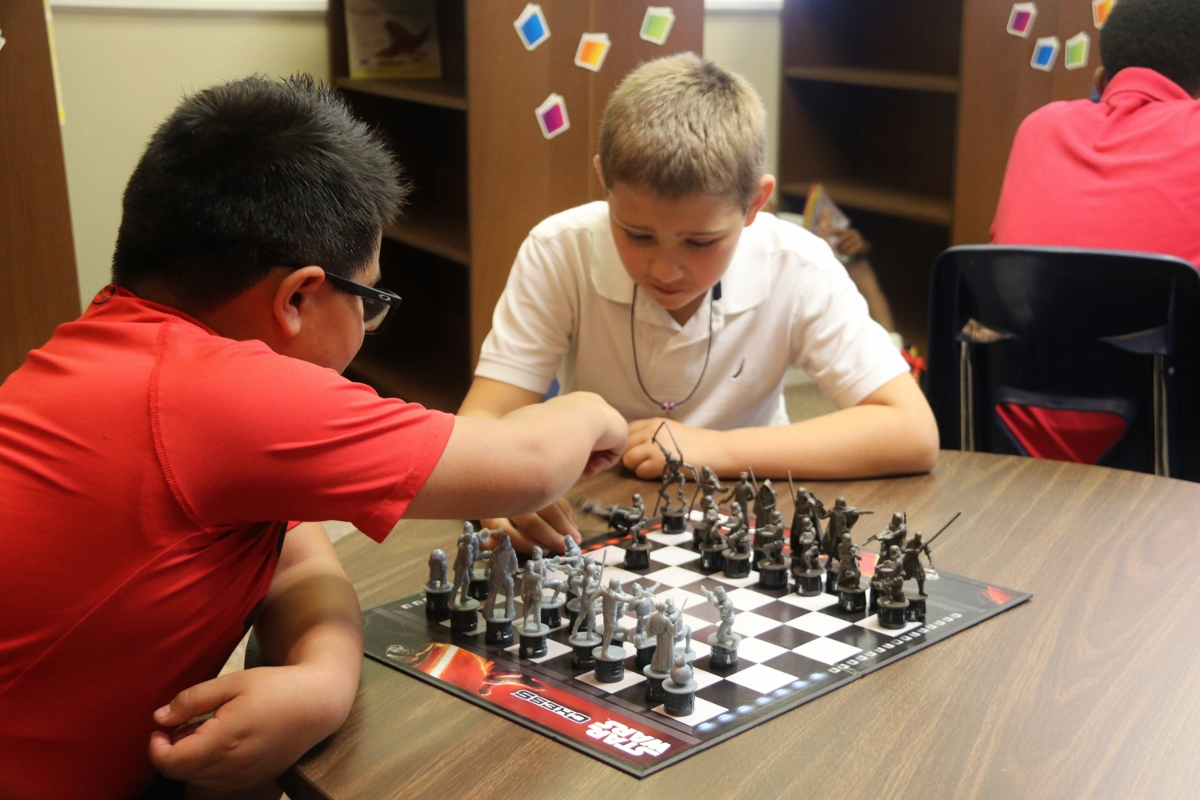 Students Playing Chess in Library