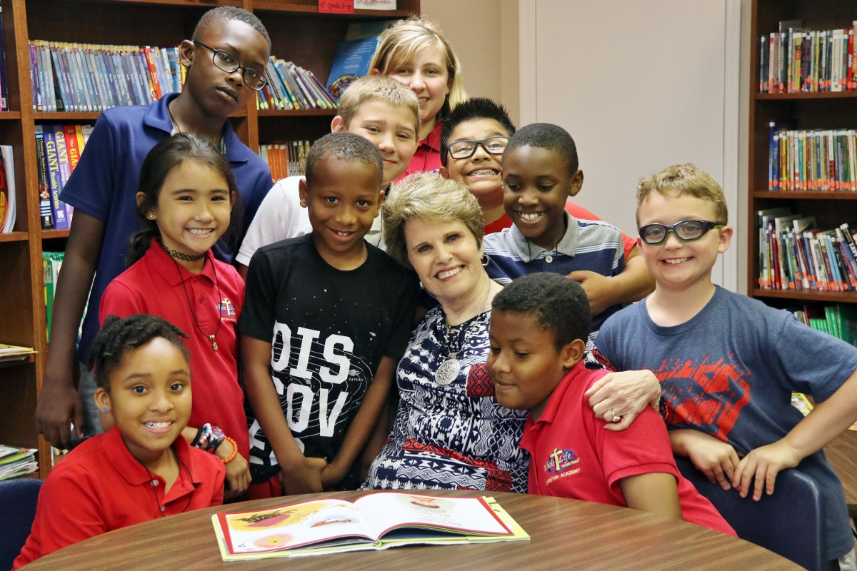 Pastor Kennedy with Academy Students in School Library